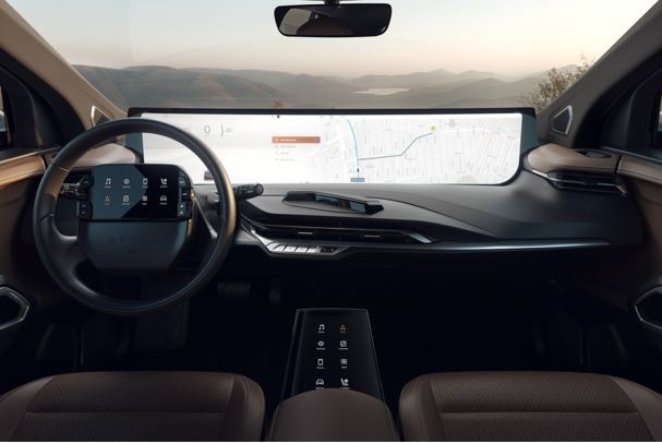 Byton's concept car premiered at CES 2019 with a 49-inch freeform display screen that spans the width of the windshield. The design also features curved touch displays in the steering wheel and a freeform center console display. (Source: The Verge)