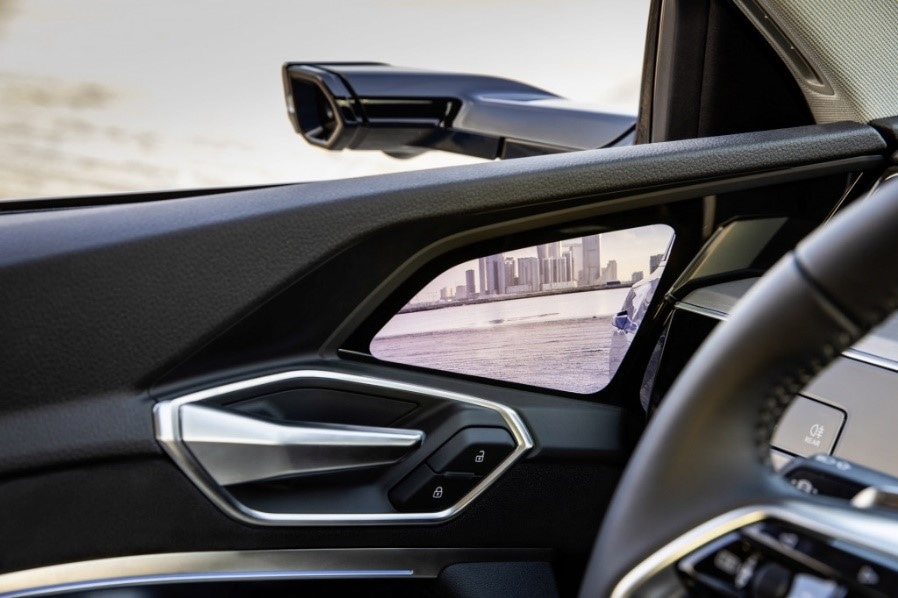 A notable exception: Audi will launch the 2019 e-tron with optional freeform OLED displays by Samsung.5 This displays will take the place of traditional side-view mirrors (in countries where regulations permit it). Has Samsung cracked the OLED-in-automotive code? (Image Source: GreenCarReports.com)
