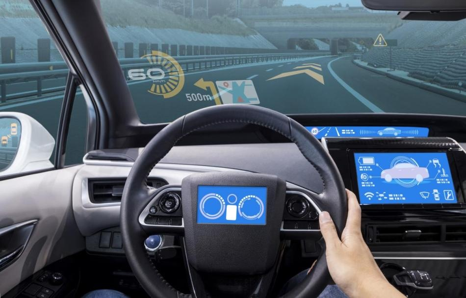 A mock-up of various display locations available in a passenger equipped with the latest ADAS, including on-steering wheel display, projected head-up display (HUD) on the car's windshield, and side mirrors integrated with camera monitoring systems (CMS).