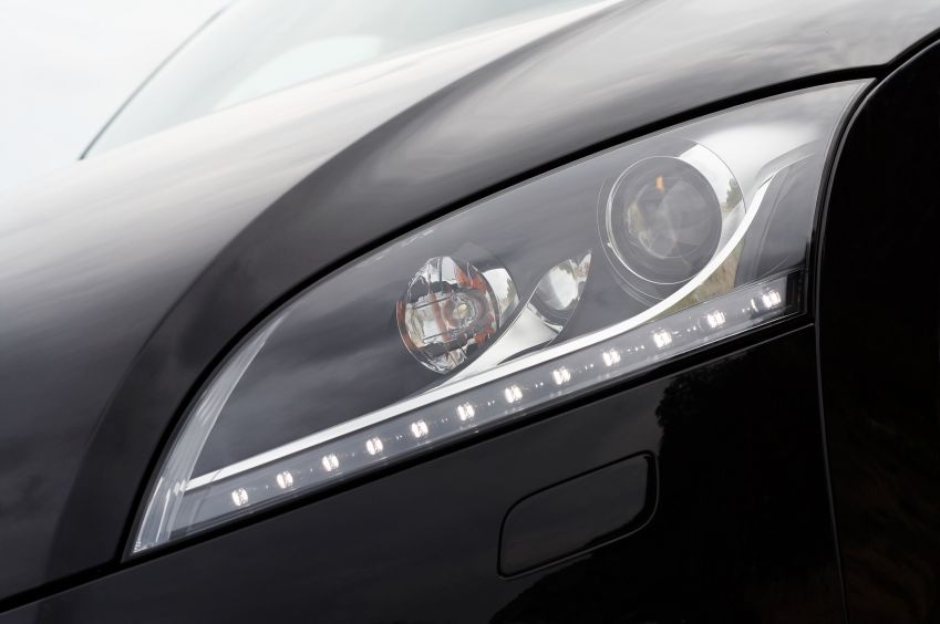 Automotive headlamp assembly with LED light strip.