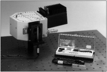 Spectral Calibration Lamp mounted to MS125™ Spectrograph, using the 77251 Lamp Mount. A diode array detector is on the output of the MS125™.