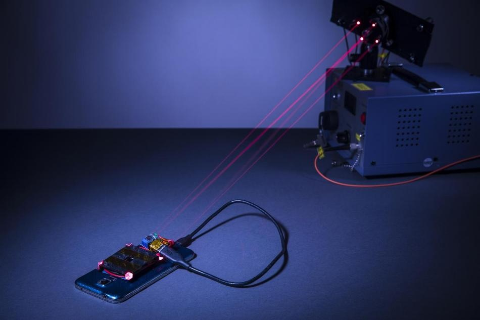 Laser-Based Technique for Wireless Charging of Mobile Devices